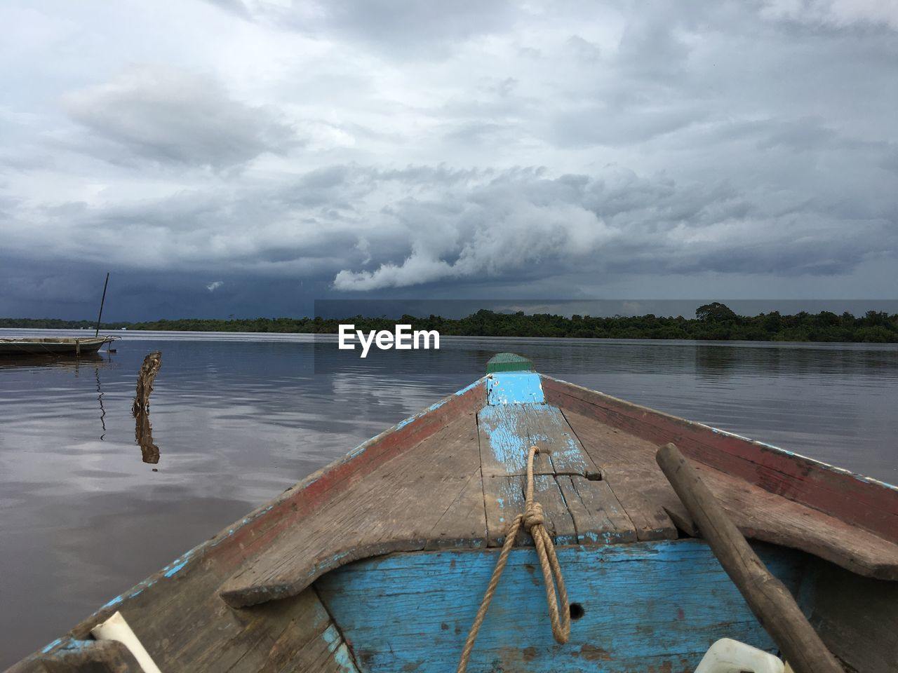 water, cloud - sky, sky, nautical vessel, mode of transportation, transportation, wood - material, nature, no people, moored, day, lake, tranquil scene, tranquility, scenics - nature, beauty in nature, non-urban scene, outdoors, oar, sailboat, fishing boat, rowboat