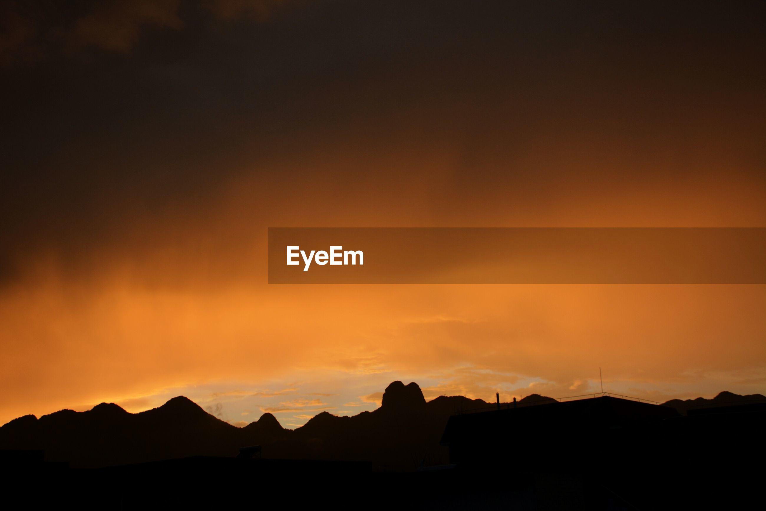sunset, silhouette, scenics, mountain, beauty in nature, tranquil scene, sky, tranquility, orange color, nature, idyllic, cloud - sky, mountain range, landscape, cloud, dramatic sky, majestic, dark, outdoors, no people, outline, non-urban scene, non urban scene, remote