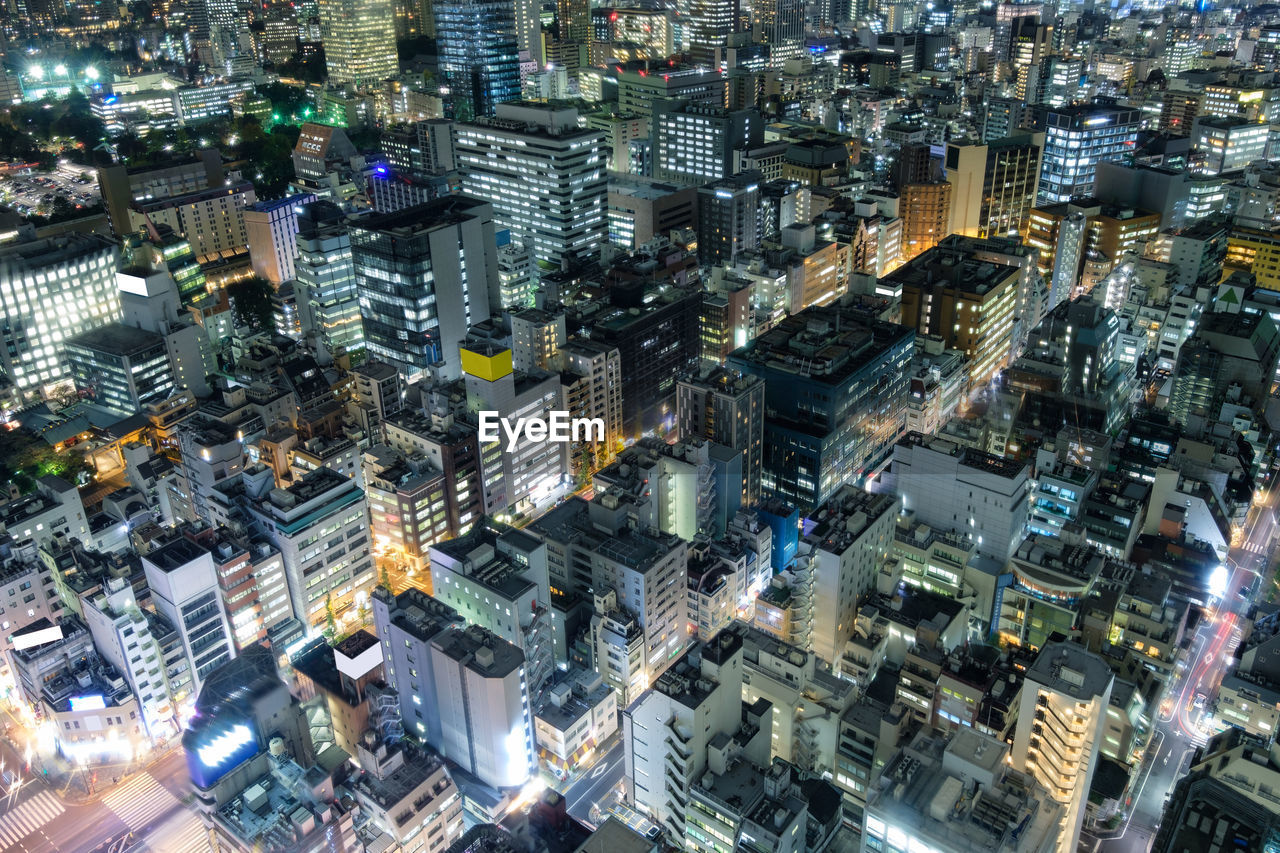 High angle view of city buildings at night