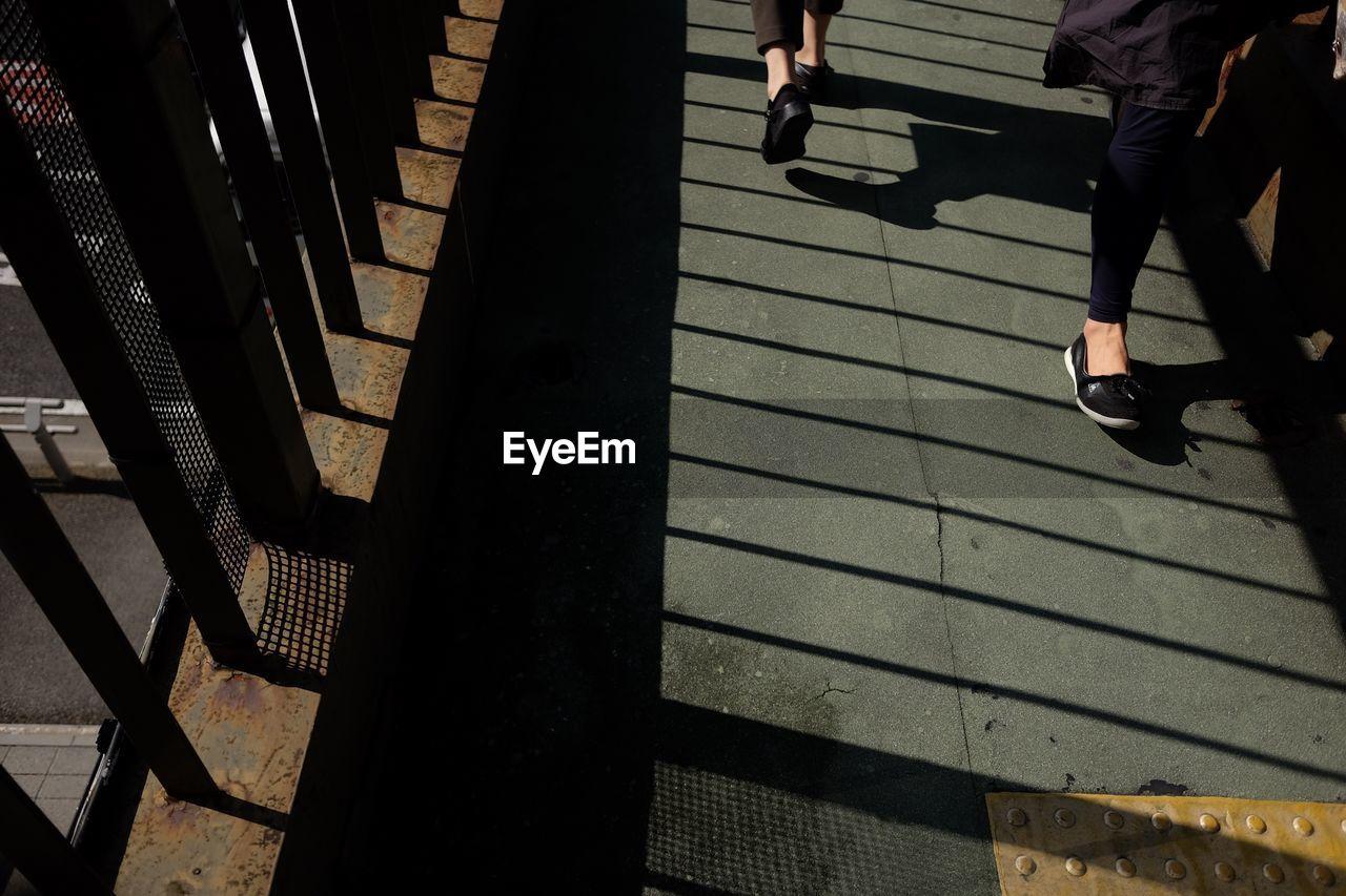 Low Section Of Women On Footbridge