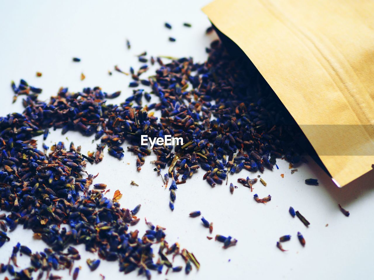 Close-Up Of Lavender Seeds On White Table