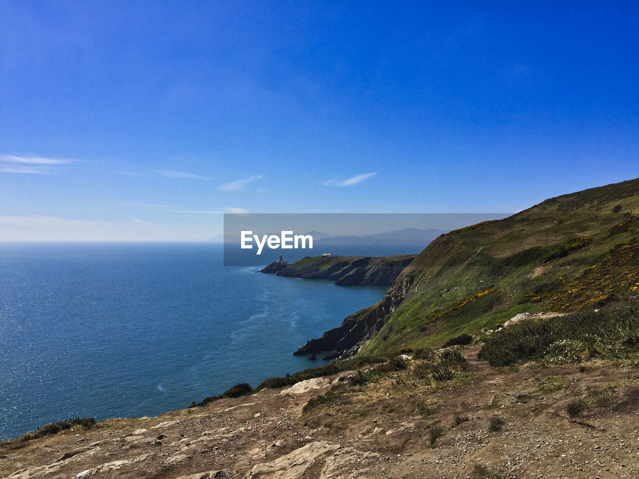 sea, water, sky, scenics - nature, tranquil scene, beauty in nature, blue, tranquility, land, beach, horizon, nature, horizon over water, day, idyllic, no people, non-urban scene, mountain, rock, outdoors, rocky coastline