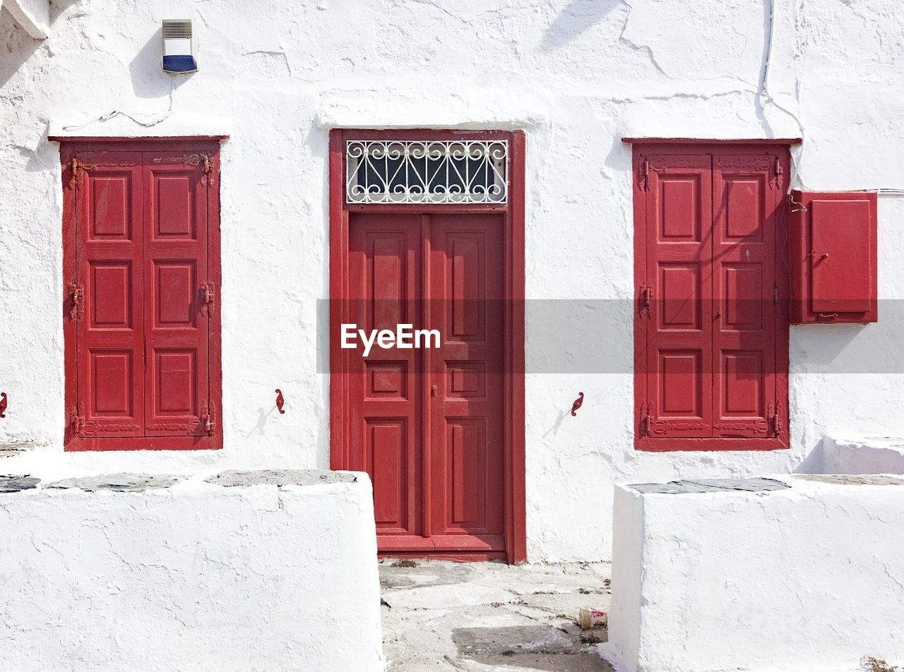 door, red, architecture, built structure, building exterior, entrance, outdoors, white color, house, day, no people, whitewashed