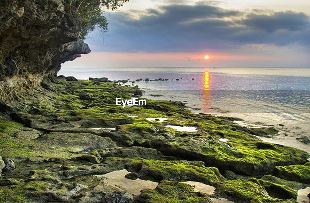 beach, sea, sunset, cloud - sky, horizon over water, rock - object, nature, water, scenics, tranquility, sky, beauty in nature, landscape, outdoors, tranquil scene, travel destinations, no people, sand, beauty, tree, vacations, lighthouse, day, wave