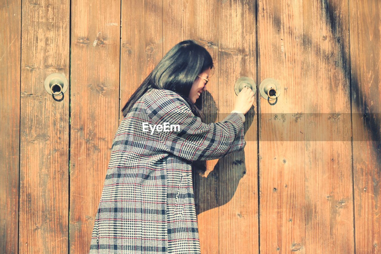 Woman Holding Door Knocker