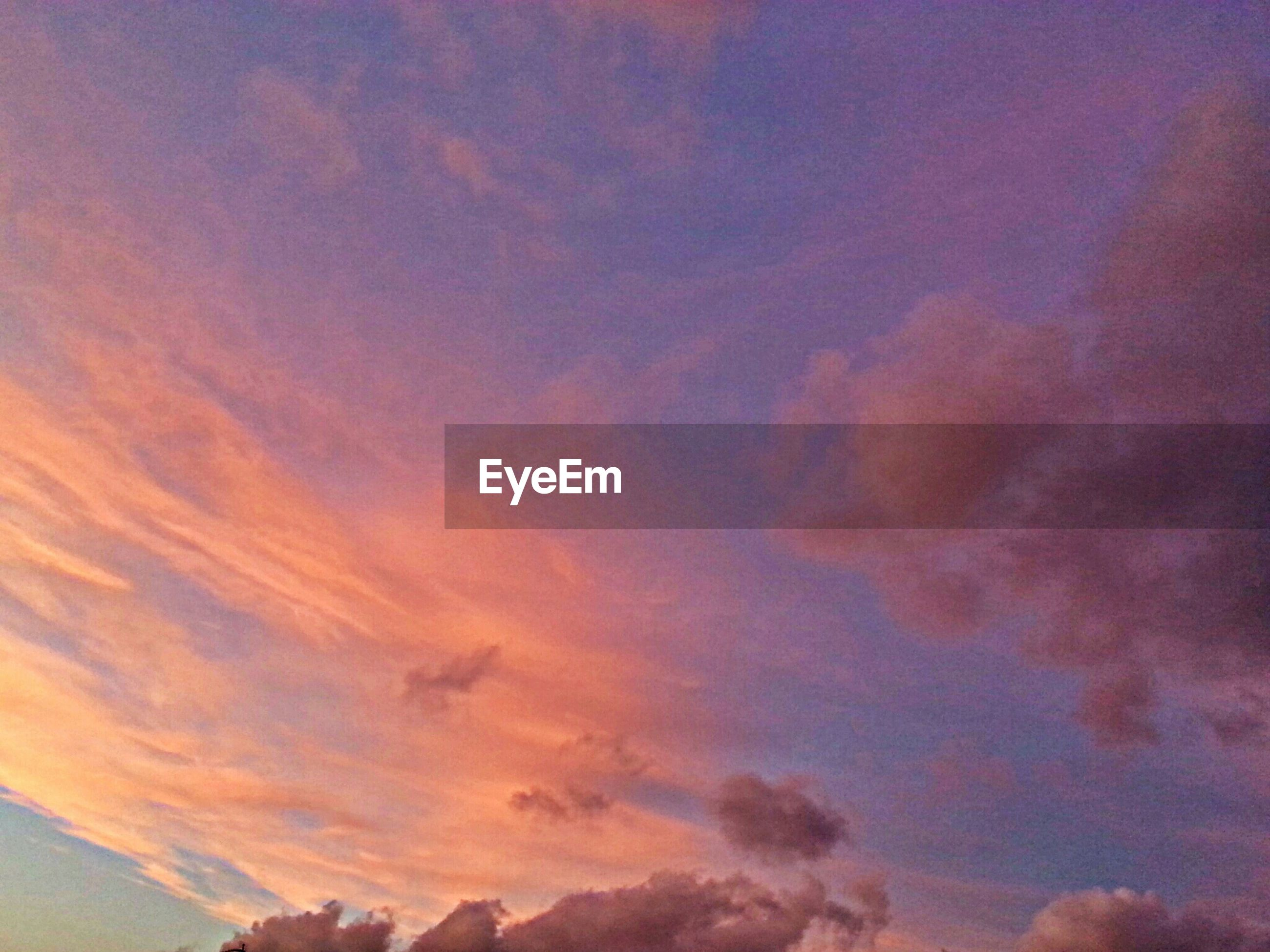 sky, cloud - sky, sunset, beauty in nature, scenics, tranquility, low angle view, tranquil scene, cloudy, orange color, nature, dramatic sky, cloud, idyllic, cloudscape, weather, majestic, outdoors, no people, atmospheric mood