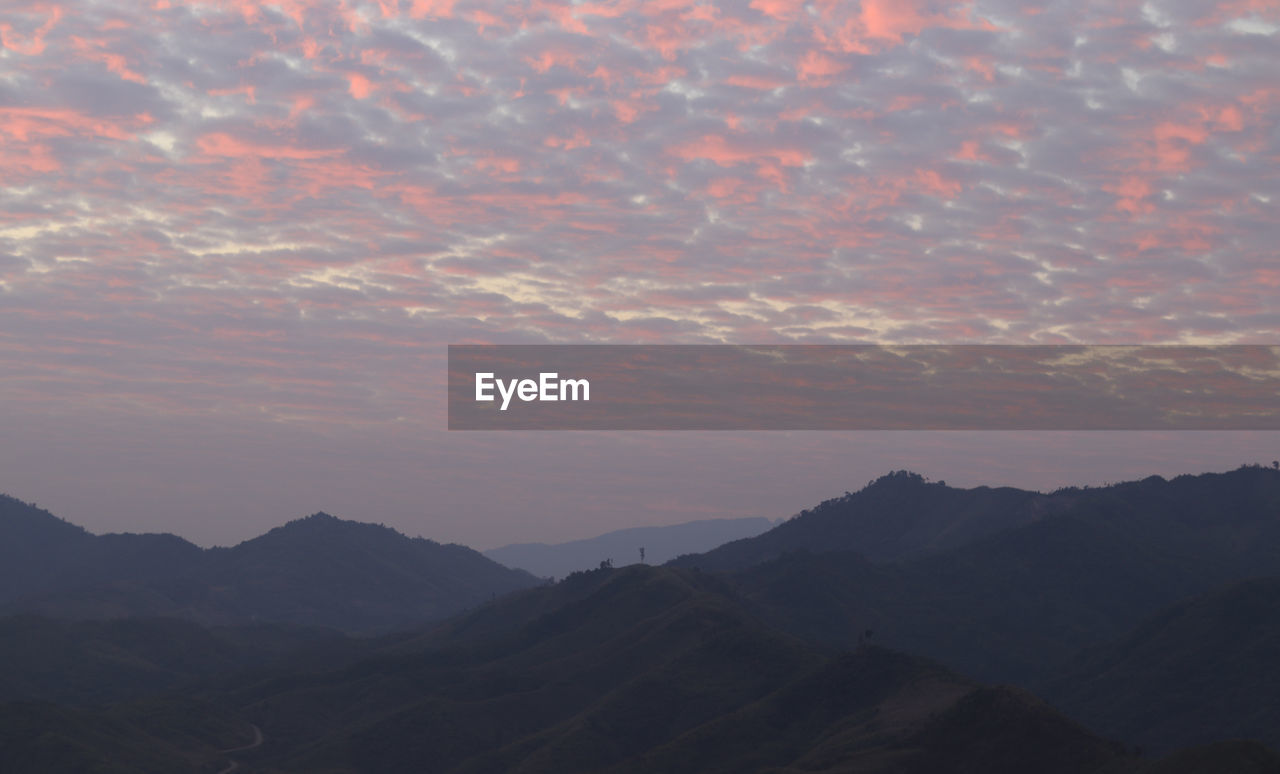 mountain, sky, cloud - sky, beauty in nature, sunset, tranquility, tranquil scene, mountain range, scenics - nature, landscape, environment, non-urban scene, nature, idyllic, no people, orange color, outdoors, remote, silhouette, mountain peak