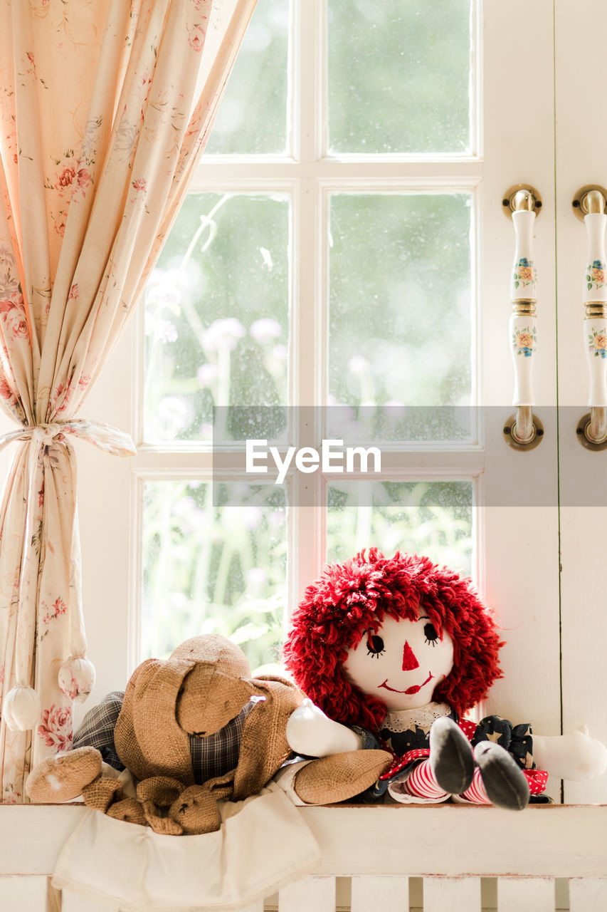 indoors, toy, window, stuffed toy, representation, no people, home interior, teddy bear, human representation, transparent, art and craft, glass - material, red, day, plant, still life, curtain, nature, textile