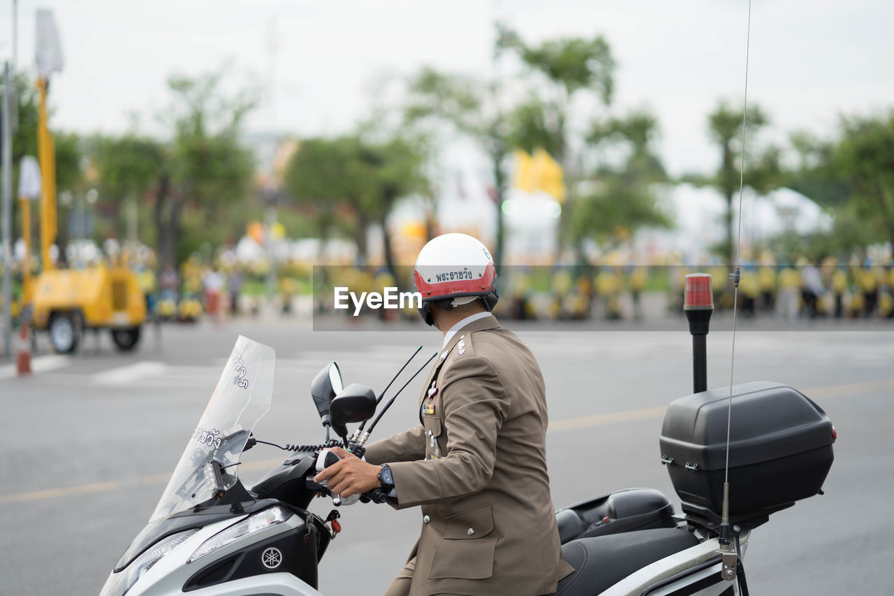 transportation, land vehicle, one person, mode of transportation, real people, bicycle, city, day, rear view, clothing, road, focus on foreground, scooter, street, motor scooter, helmet, hat, riding, motorcycle, outdoors, crash helmet