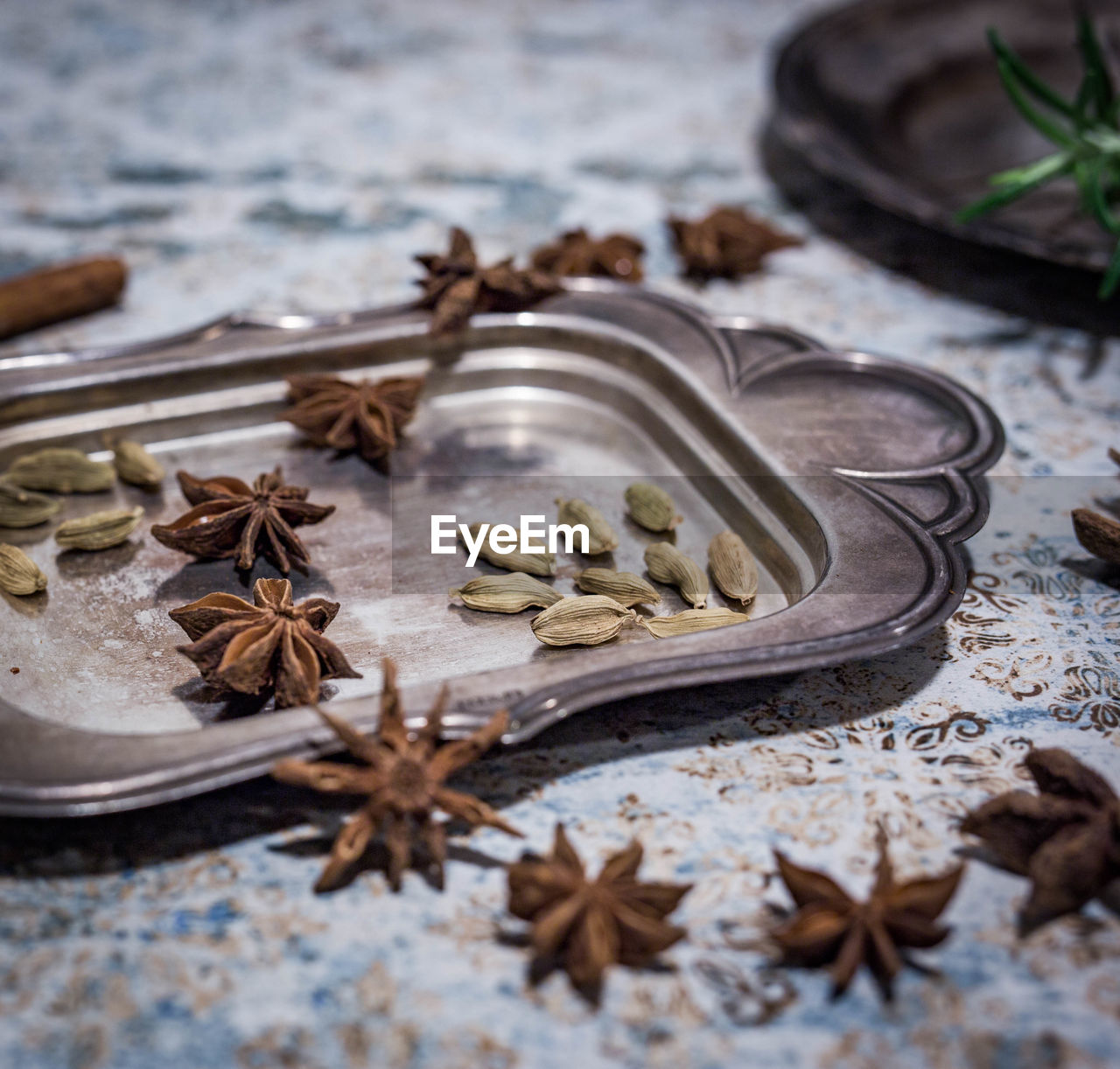 spice, food and drink, food, cinnamon, star anise, freshness, no people, close-up, ingredient, wood - material, high angle view, selective focus, kitchen utensil, anise, nut, healthy eating, vanilla, clove, dried food, hazelnut, cardamom