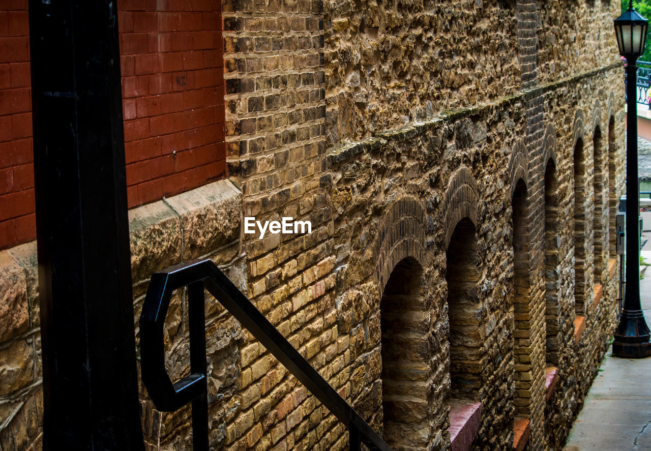 architecture, wall - building feature, built structure, wall, brick wall, building, brick, no people, old, building exterior, day, outdoors, wood - material, the past, history, stone wall, art and craft, railing