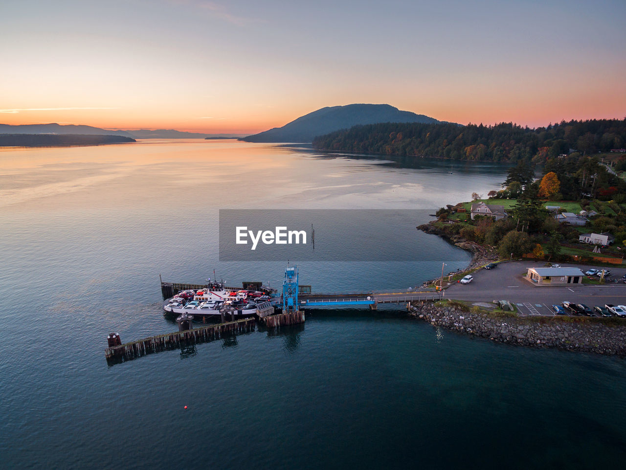 water, sky, sea, sunset, scenics - nature, transportation, architecture, beauty in nature, nautical vessel, nature, waterfront, built structure, no people, building exterior, high angle view, mountain, cloud - sky, mode of transportation, pier, outdoors