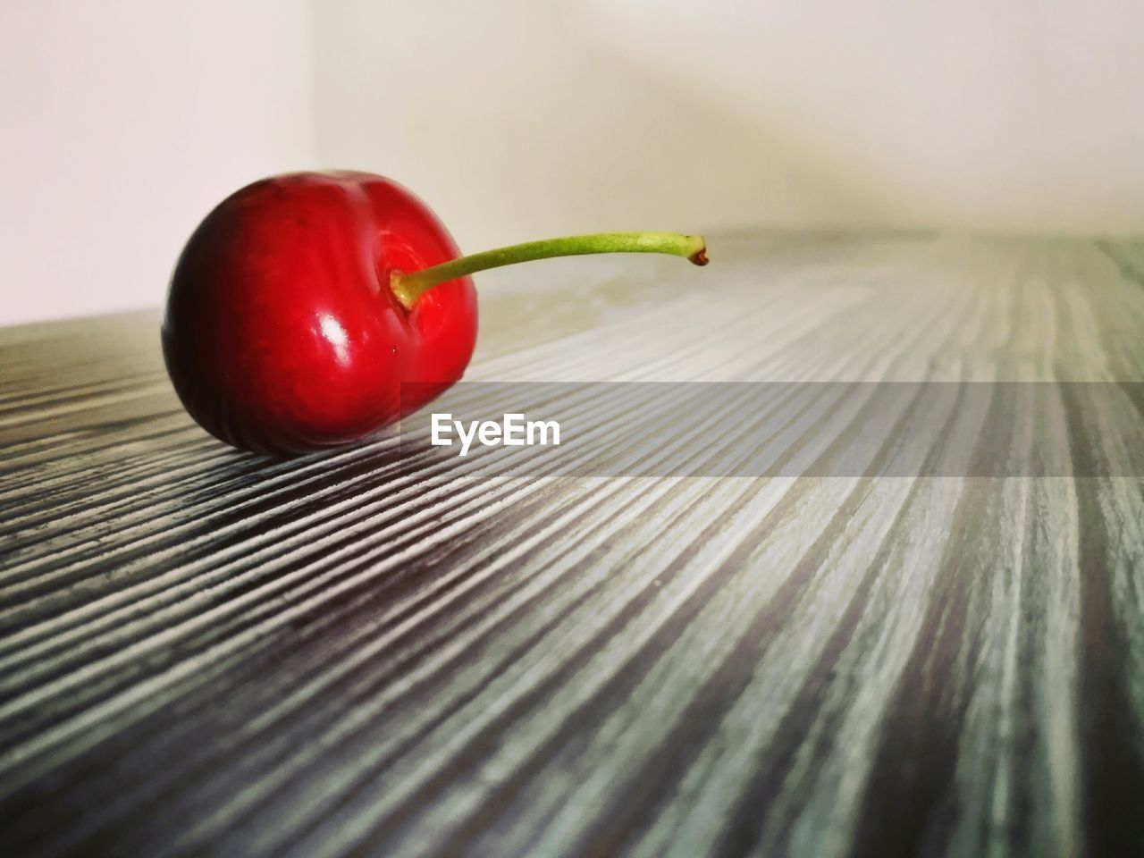 Close-Up Of Cherry Fruit On Table
