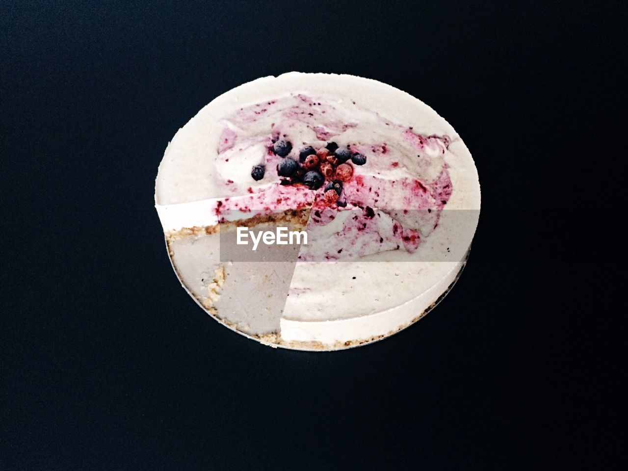High angle view of cake over black background