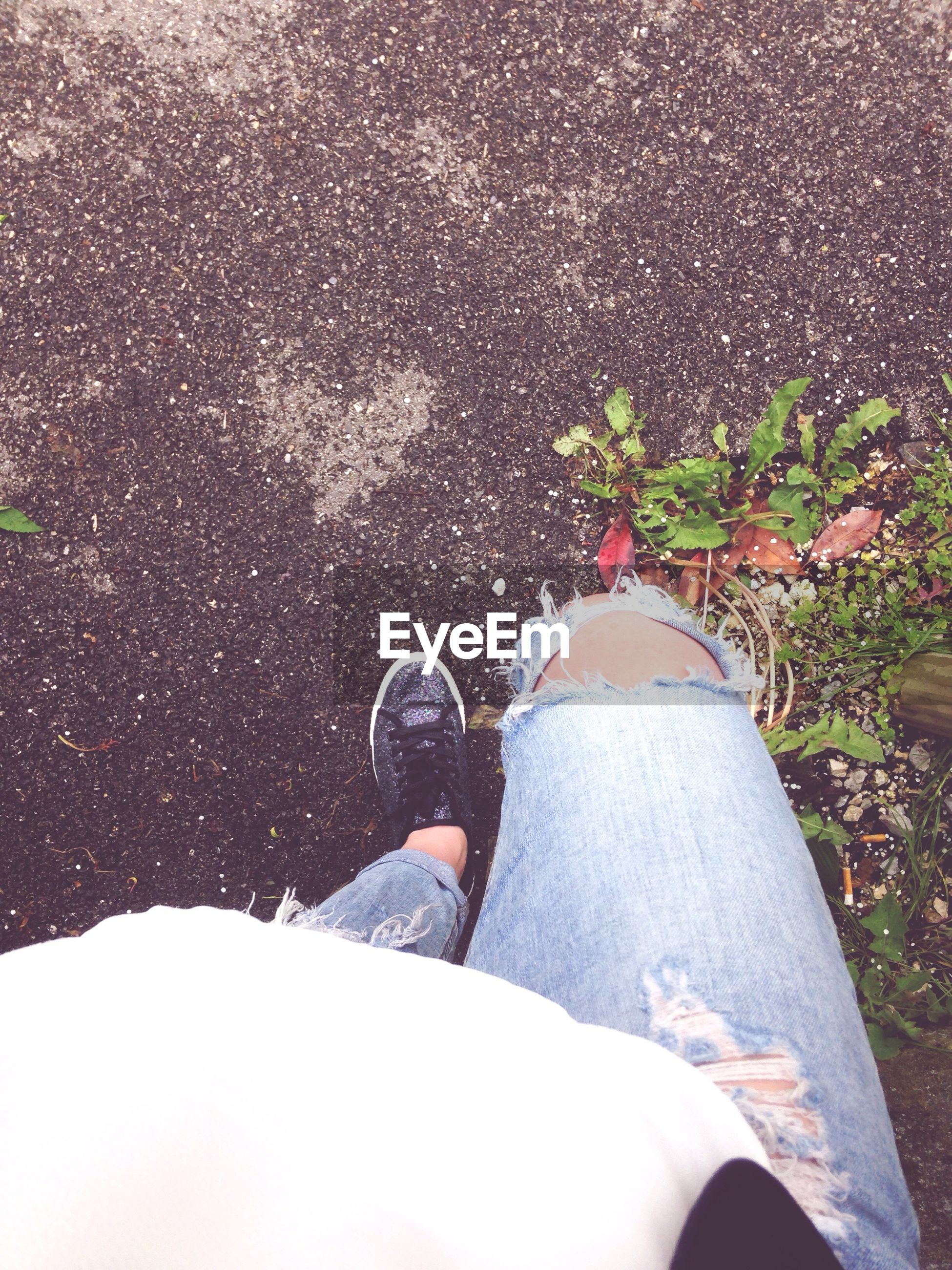 low section, person, lifestyles, personal perspective, leisure activity, shoe, high angle view, human foot, men, standing, casual clothing, footwear, sunlight, sitting, day, part of