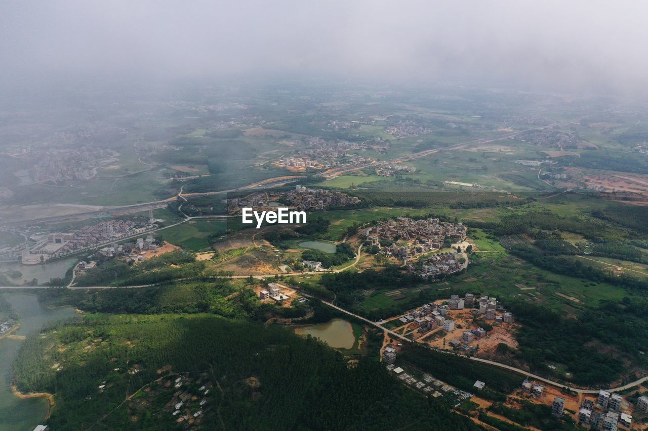 HIGH ANGLE VIEW OF LANDSCAPE DURING FOG