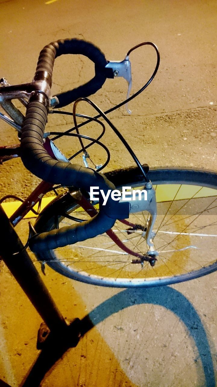 bicycle, transportation, mode of transport, stationary, high angle view, land vehicle, day, no people, outdoors, bicycle rack, shadow, close-up