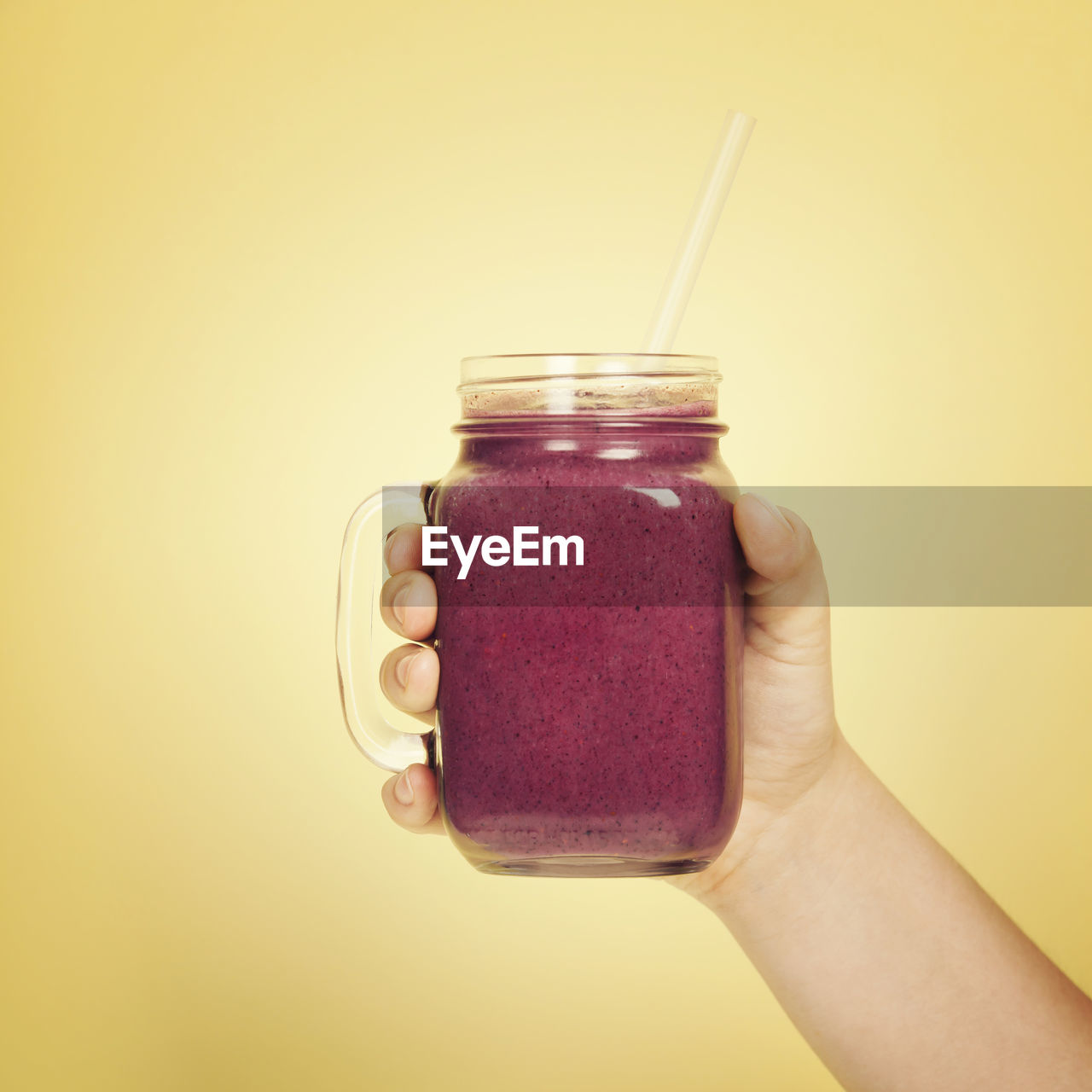 human hand, holding, hand, jar, human body part, food and drink, one person, studio shot, container, indoors, lifestyles, close-up, food, refreshment, drink, wellbeing, drinking straw, straw, personal perspective, body part, finger, glass, breakfast