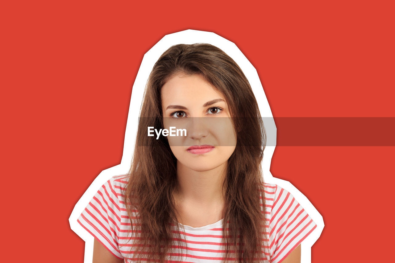 Cut out of young woman against red background