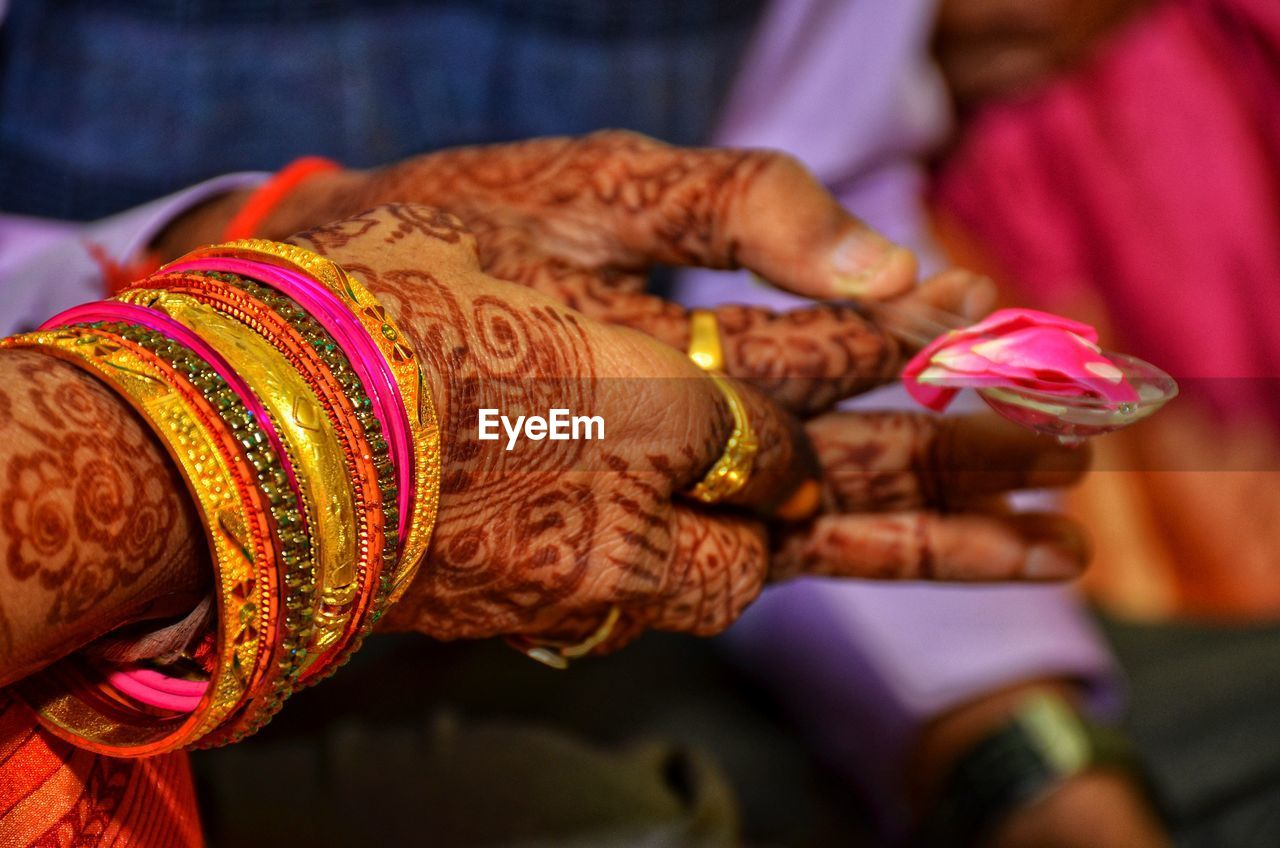 human hand, women, wedding, hand, tattoo, bride, henna tattoo, real people, newlywed, adult, focus on foreground, two people, event, life events, celebration, indoors, flower, wedding ceremony