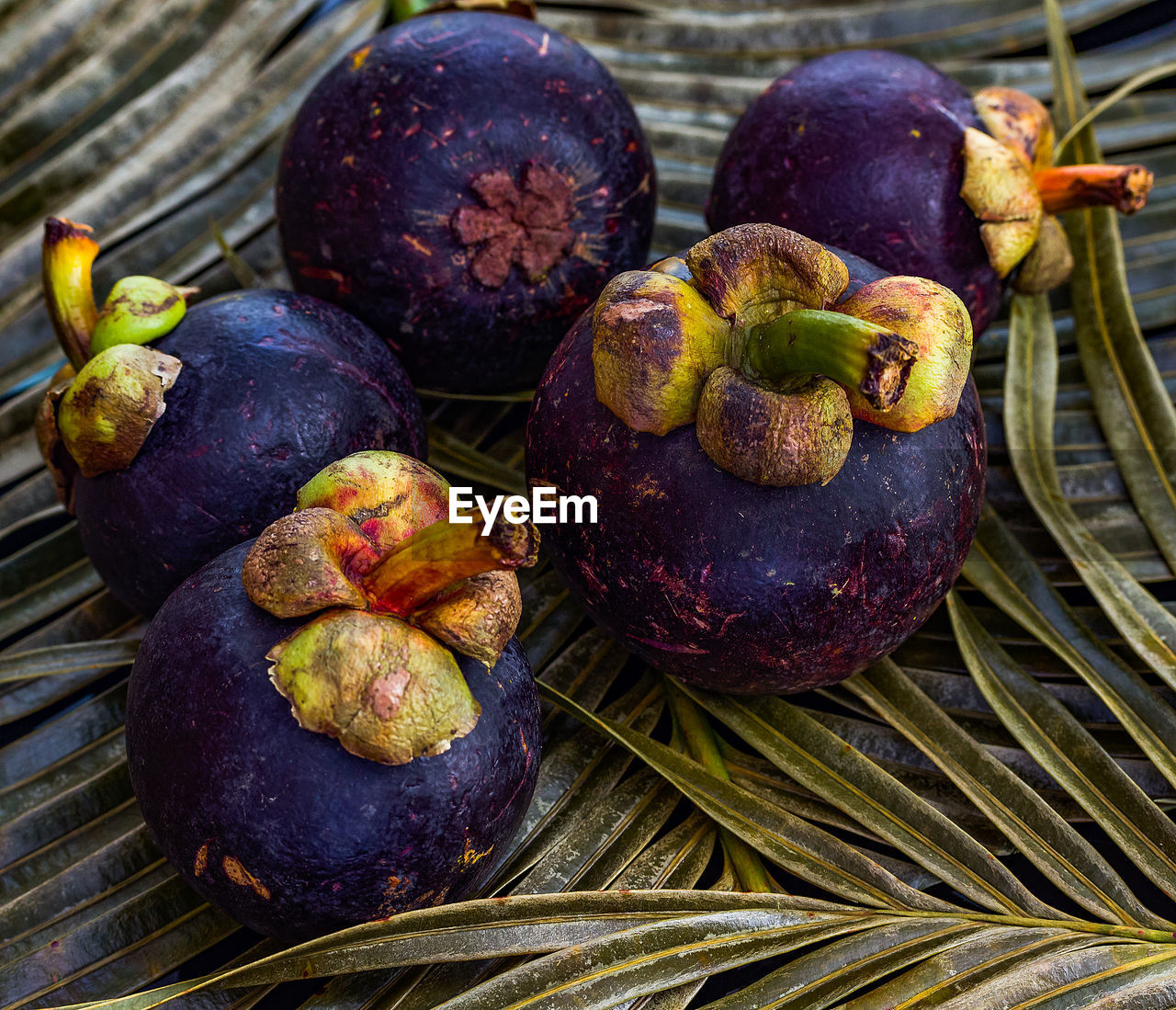 food and drink, food, healthy eating, freshness, wellbeing, fruit, close-up, no people, high angle view, still life, leaf, day, plant part, wood - material, tropical fruit, nature, outdoors, focus on foreground, basket, ripe