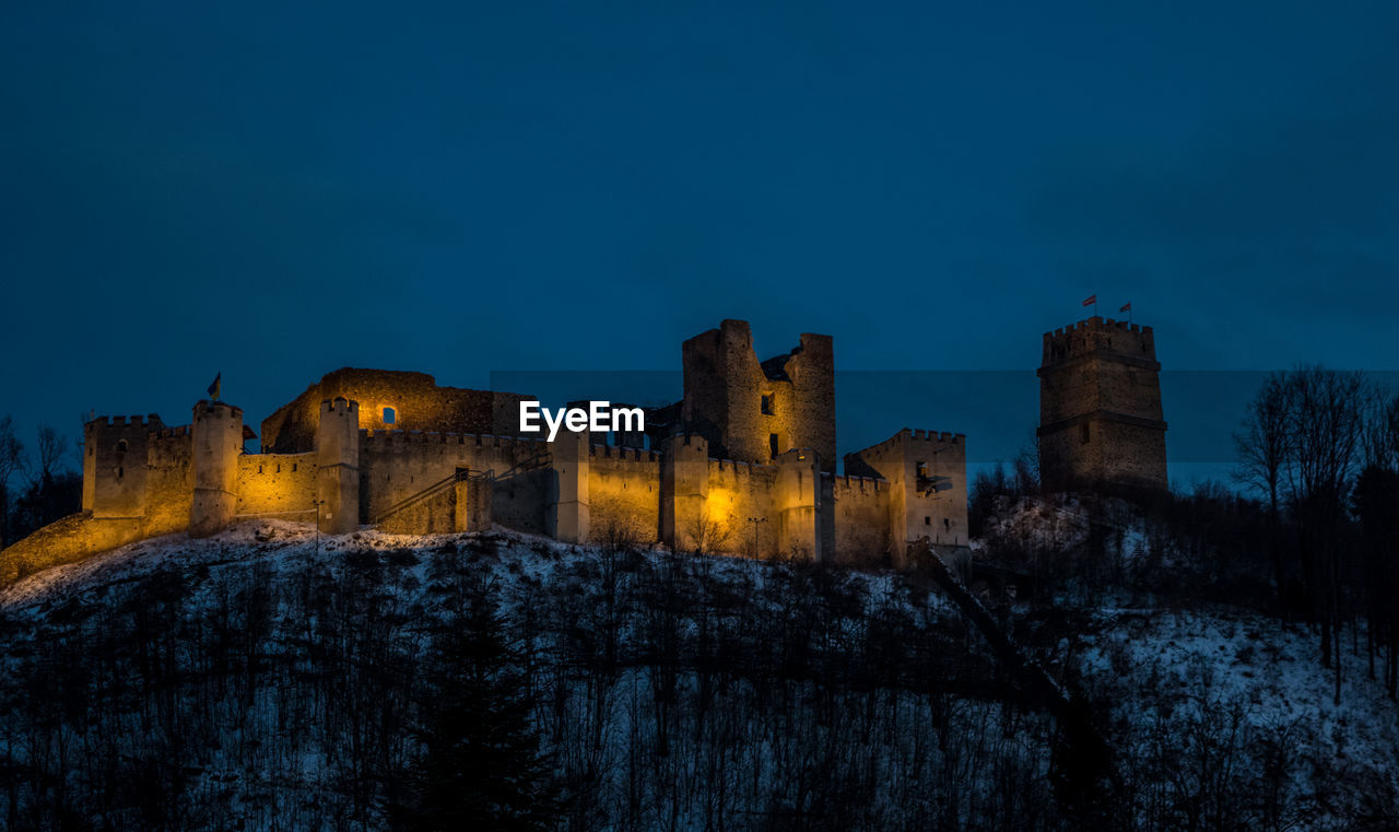 architecture, sky, built structure, building exterior, history, the past, blue, nature, copy space, building, ancient, no people, castle, fort, old, tree, illuminated, night, outdoors, clear sky, ancient civilization