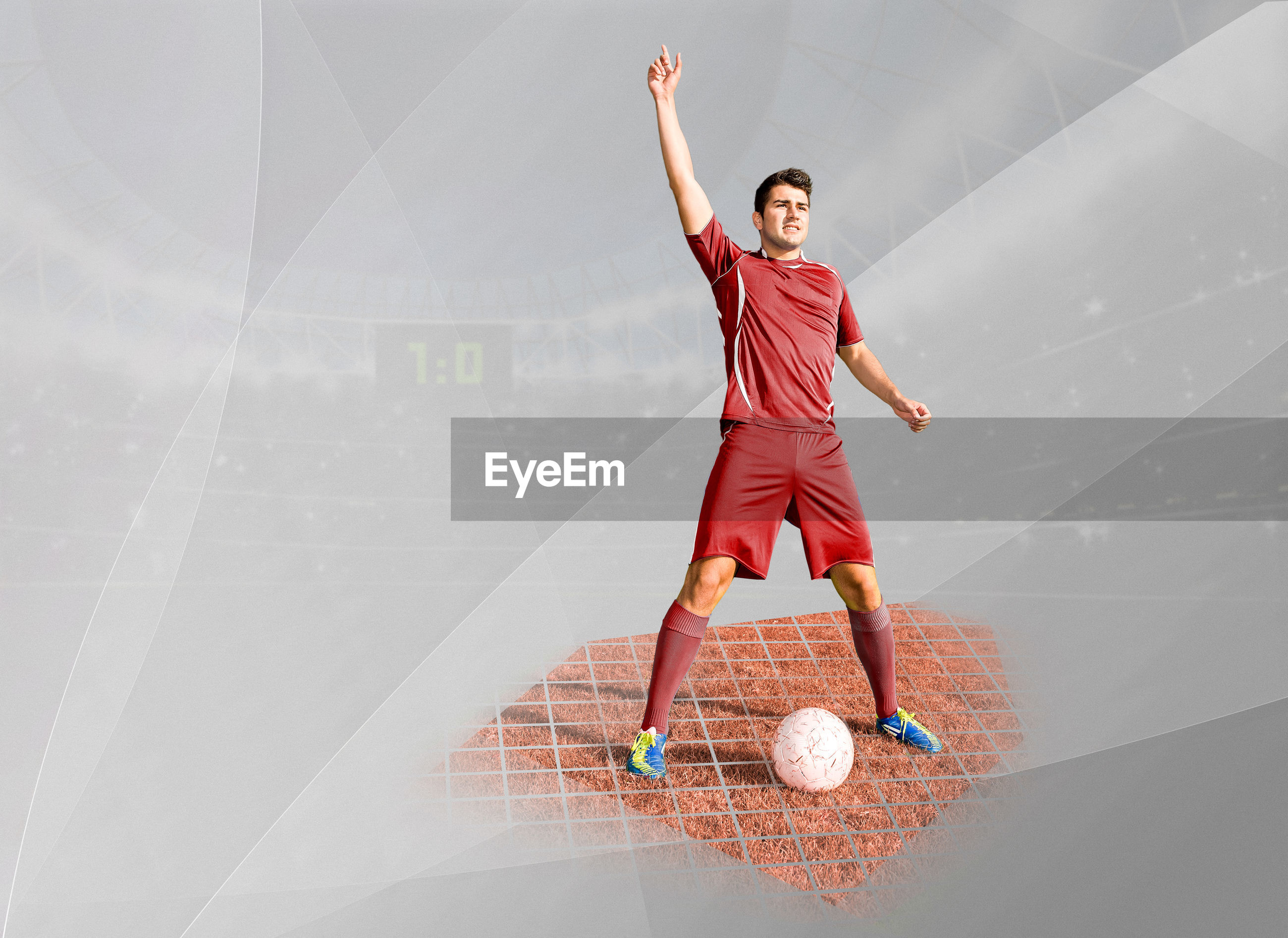 Digital composite image of soccer player with ball standing in stadium