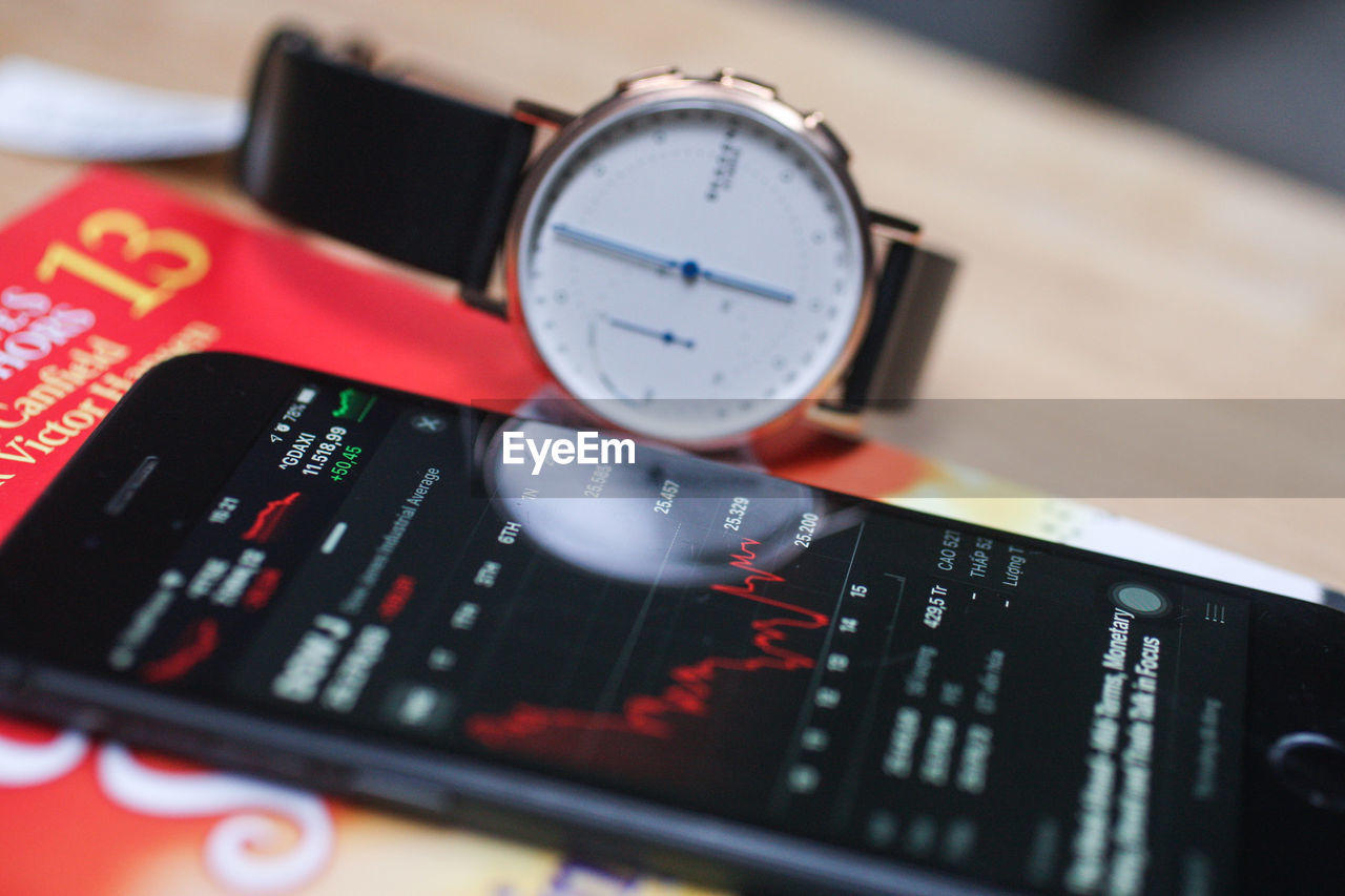 number, close-up, technology, indoors, no people, text, still life, selective focus, communication, table, red, time, focus on foreground, accuracy, high angle view, instrument of measurement, black color, control, equipment, connection, personal accessory