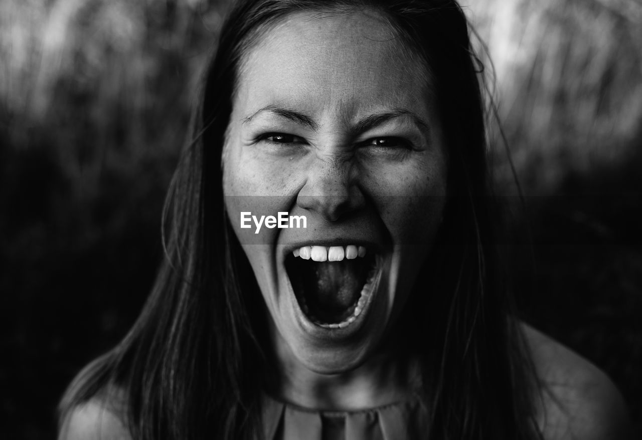 Portrait Of Young Woman Screaming