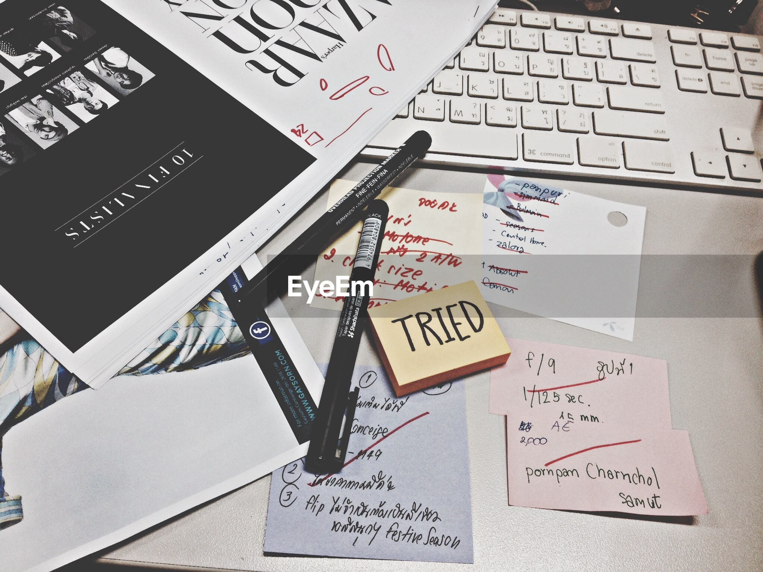 text, communication, western script, indoors, paper, number, close-up, capital letter, information, non-western script, handwriting, book, message, sign, information sign, education, high angle view, technology, arrow symbol, guidance