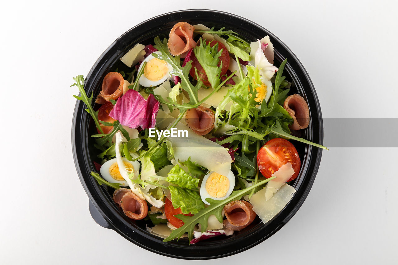 food and drink, vegetable, wellbeing, food, healthy eating, freshness, bowl, still life, studio shot, indoors, white background, salad, tomato, high angle view, ready-to-eat, directly above, lettuce, serving size, no people, close-up, vegetarian food, temptation