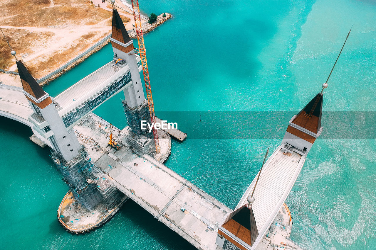 water, nautical vessel, sea, transportation, high angle view, mode of transportation, turquoise colored, nature, day, no people, blue, outdoors, ship, moored, scenics - nature, architecture, tranquility, travel, beauty in nature