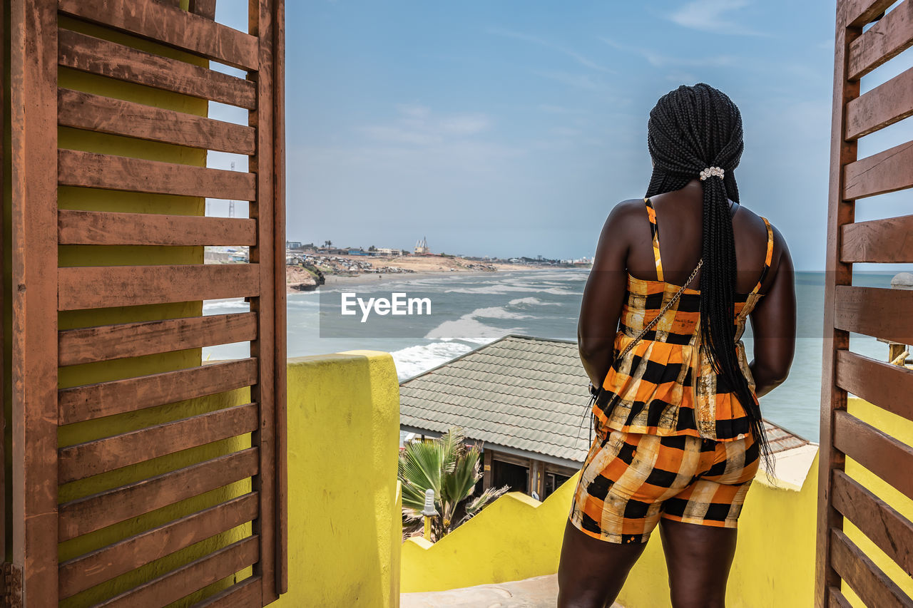 Africa woman looks out over the city of accra in ghana.