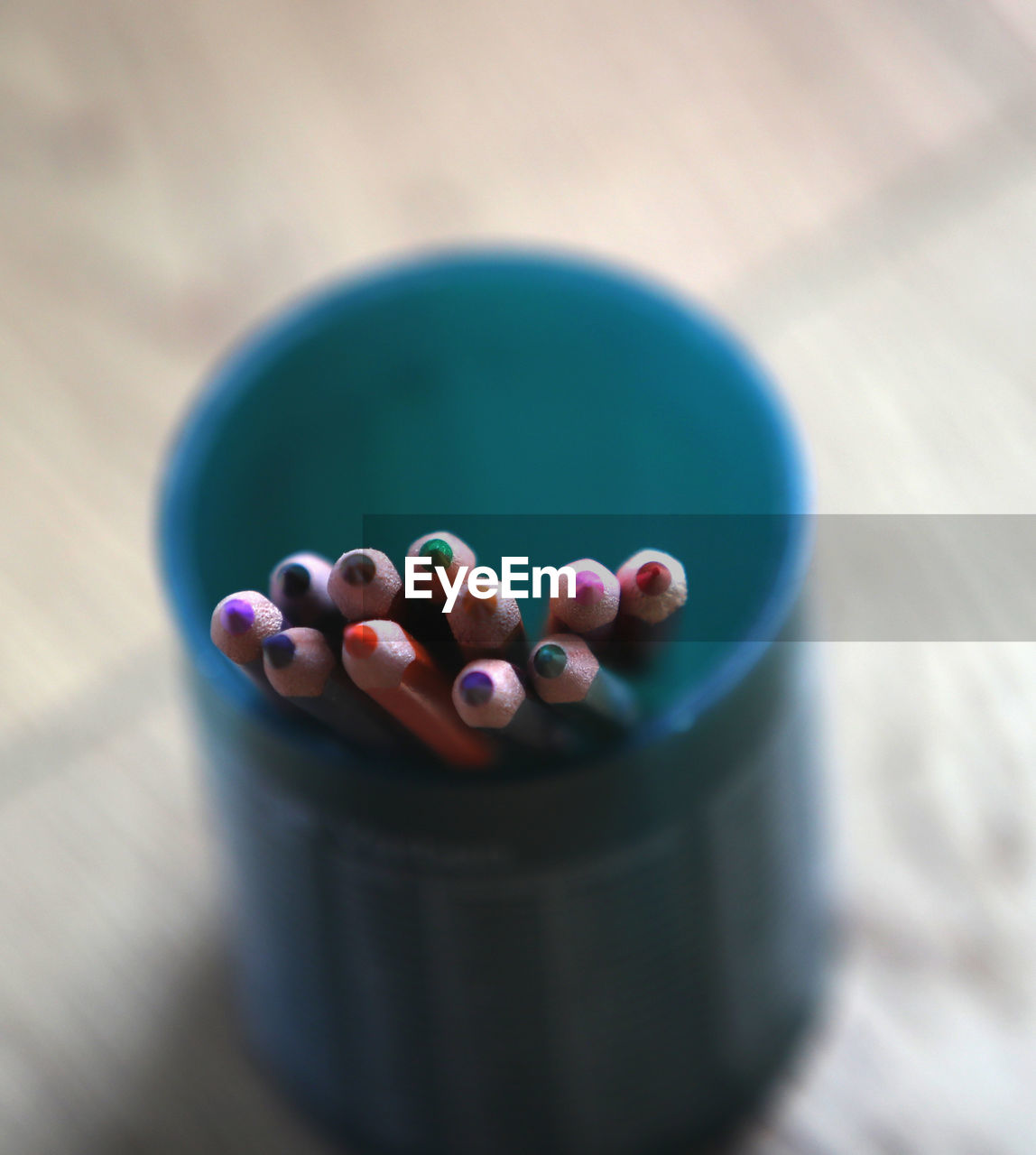 close-up, selective focus, still life, table, indoors, no people, multi colored, blue, high angle view, focus on foreground, geometric shape, circle, large group of objects, ball, food and drink, food, container, shape, day, design