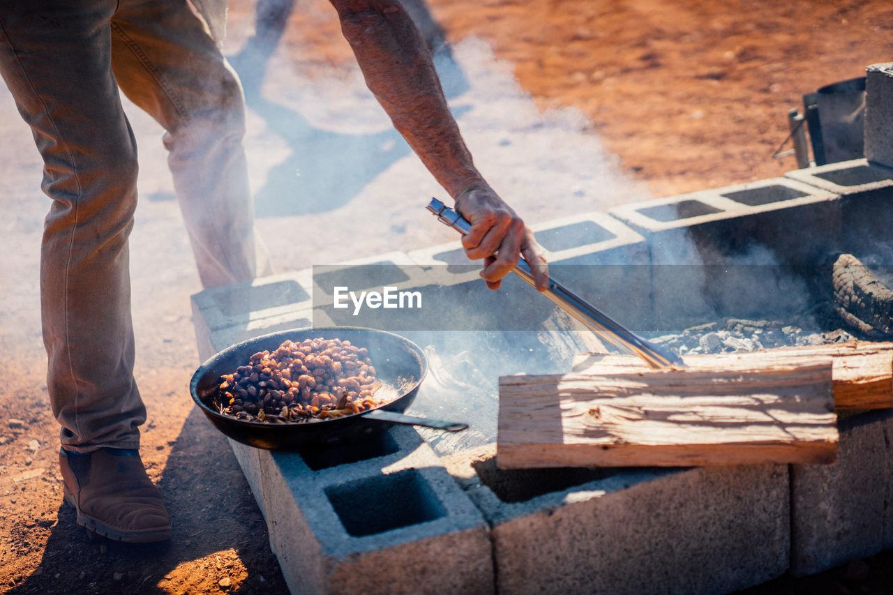 Low Section Of Man Preparing Food