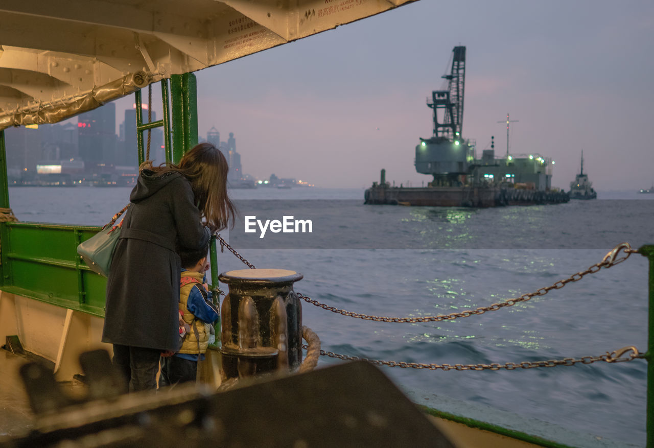 real people, one person, occupation, sea, working, industry, outdoors, standing, nautical vessel, day, water, sky, nature, drilling rig, oil pump, people