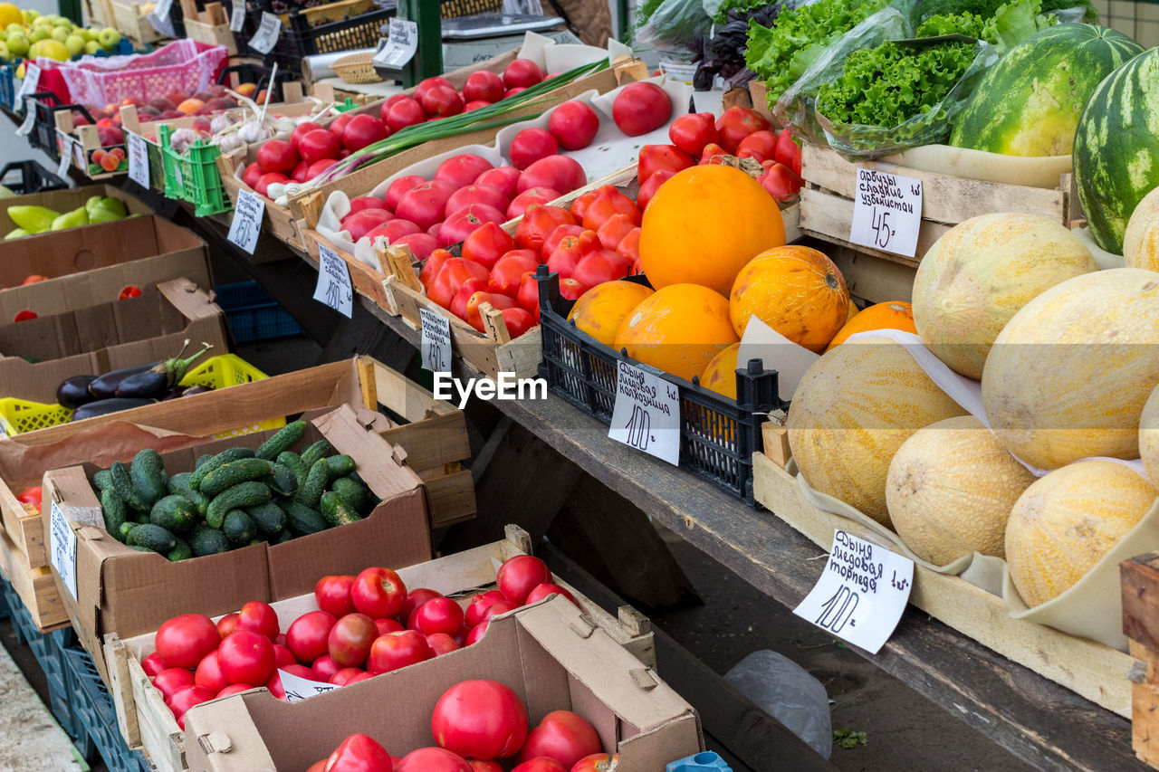 food and drink, food, market, retail, choice, fruit, healthy eating, vegetable, variation, freshness, market stall, wellbeing, large group of objects, abundance, price tag, container, for sale, box, high angle view, retail display, no people, organic, orange, sale, outdoors, ripe