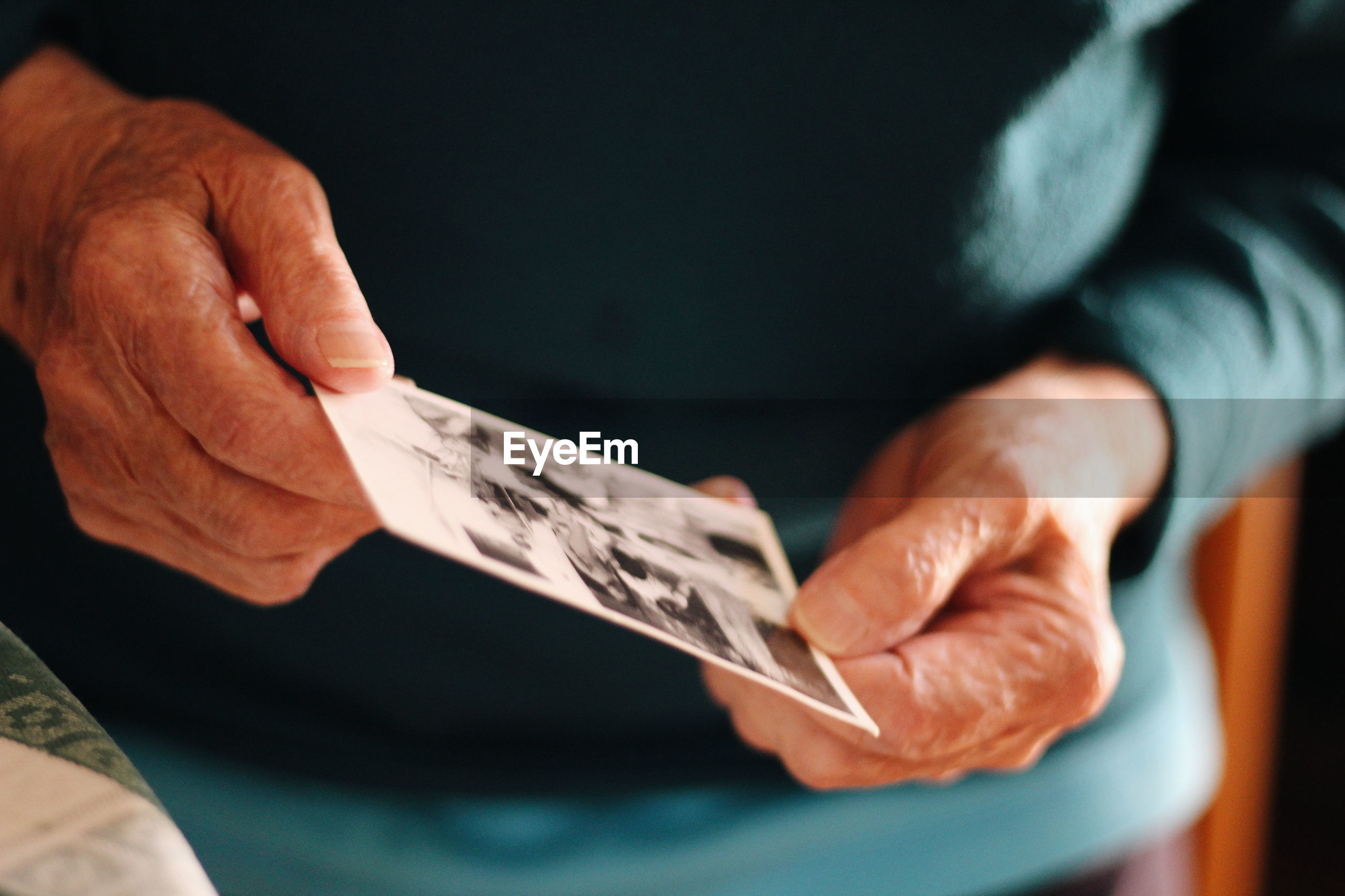 Midsection of man holding photograph