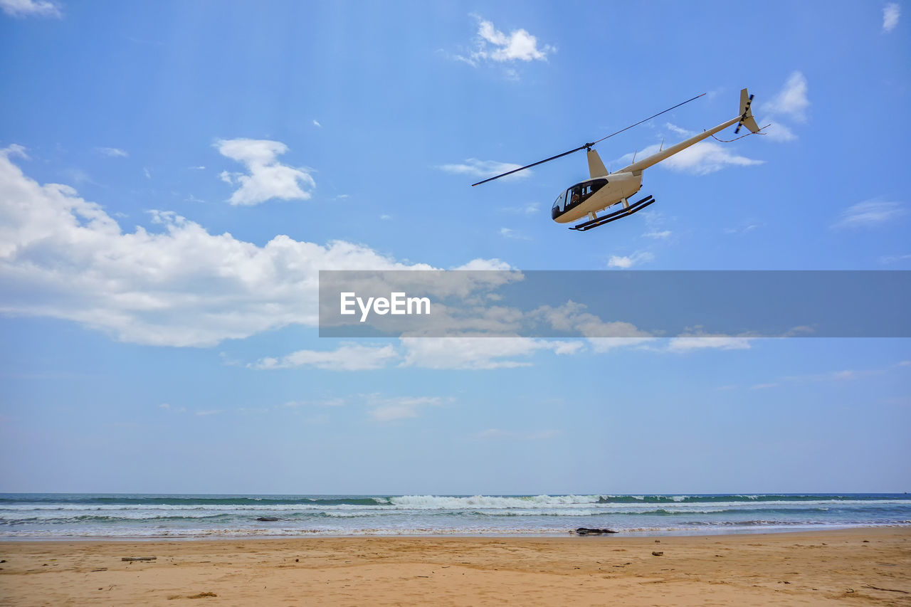 HELICOPTER FLYING OVER SEA