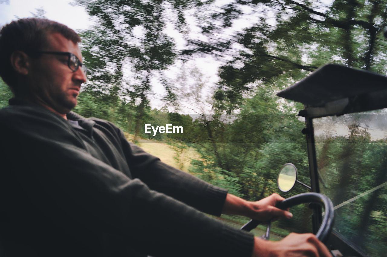 Man riding vehicle