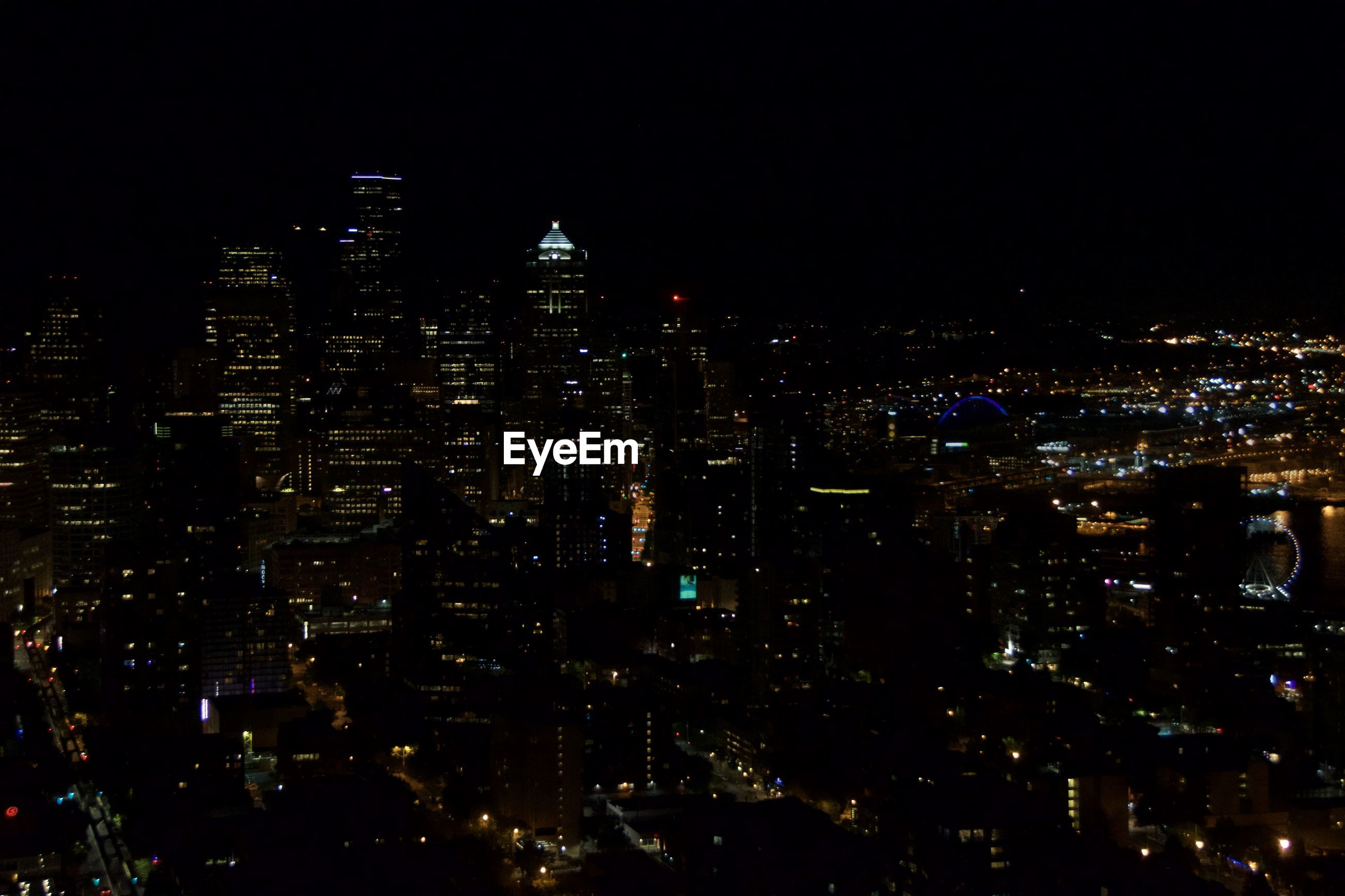 HIGH ANGLE VIEW OF CITY AT NIGHT