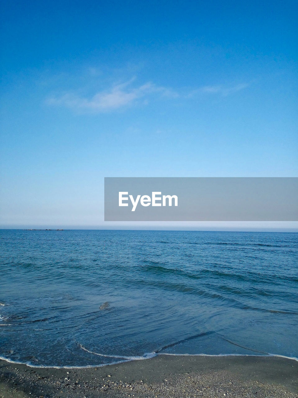 sea, blue, water, horizon over water, beauty in nature, scenics, nature, tranquil scene, tranquility, beach, outdoors, day, clear sky, sky, no people, sand