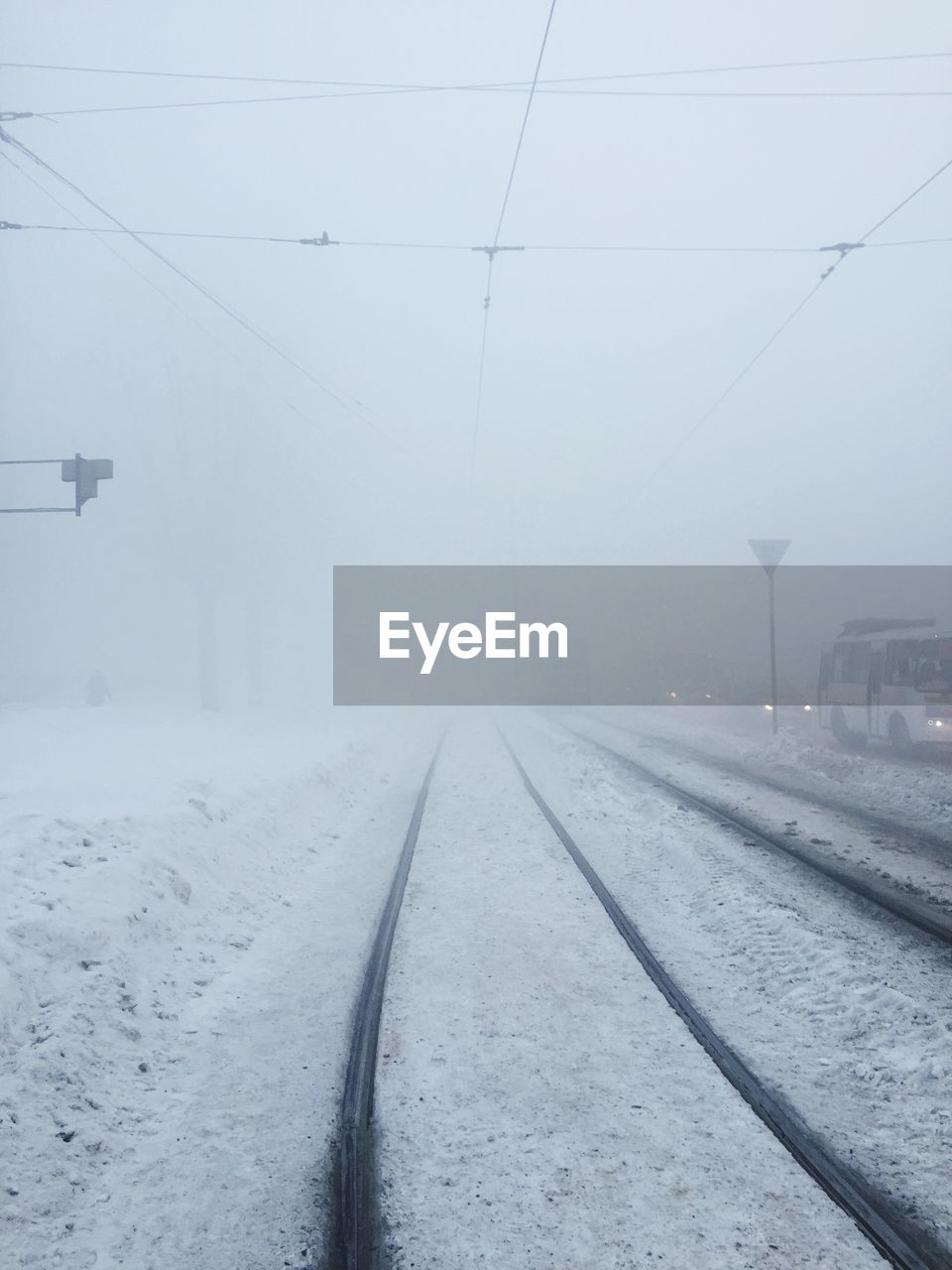 Snow Covered Railroad Tracks During Winter