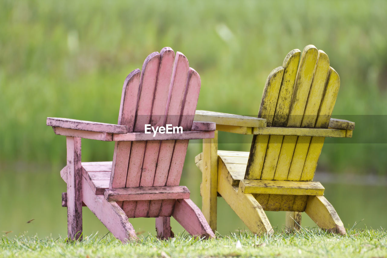 WOODEN CHAIRS ON FIELD
