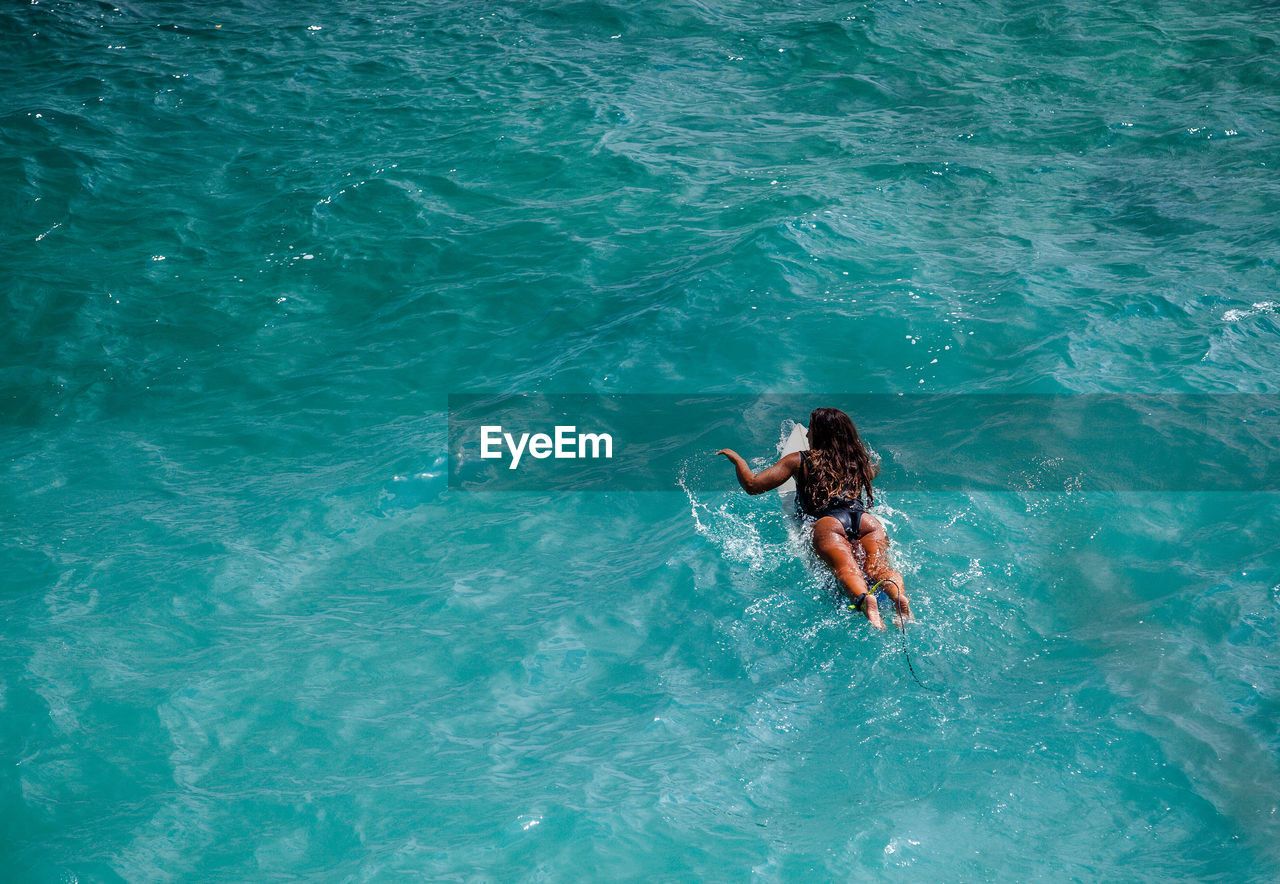 High Angle View Of Woman Swimming In Sea