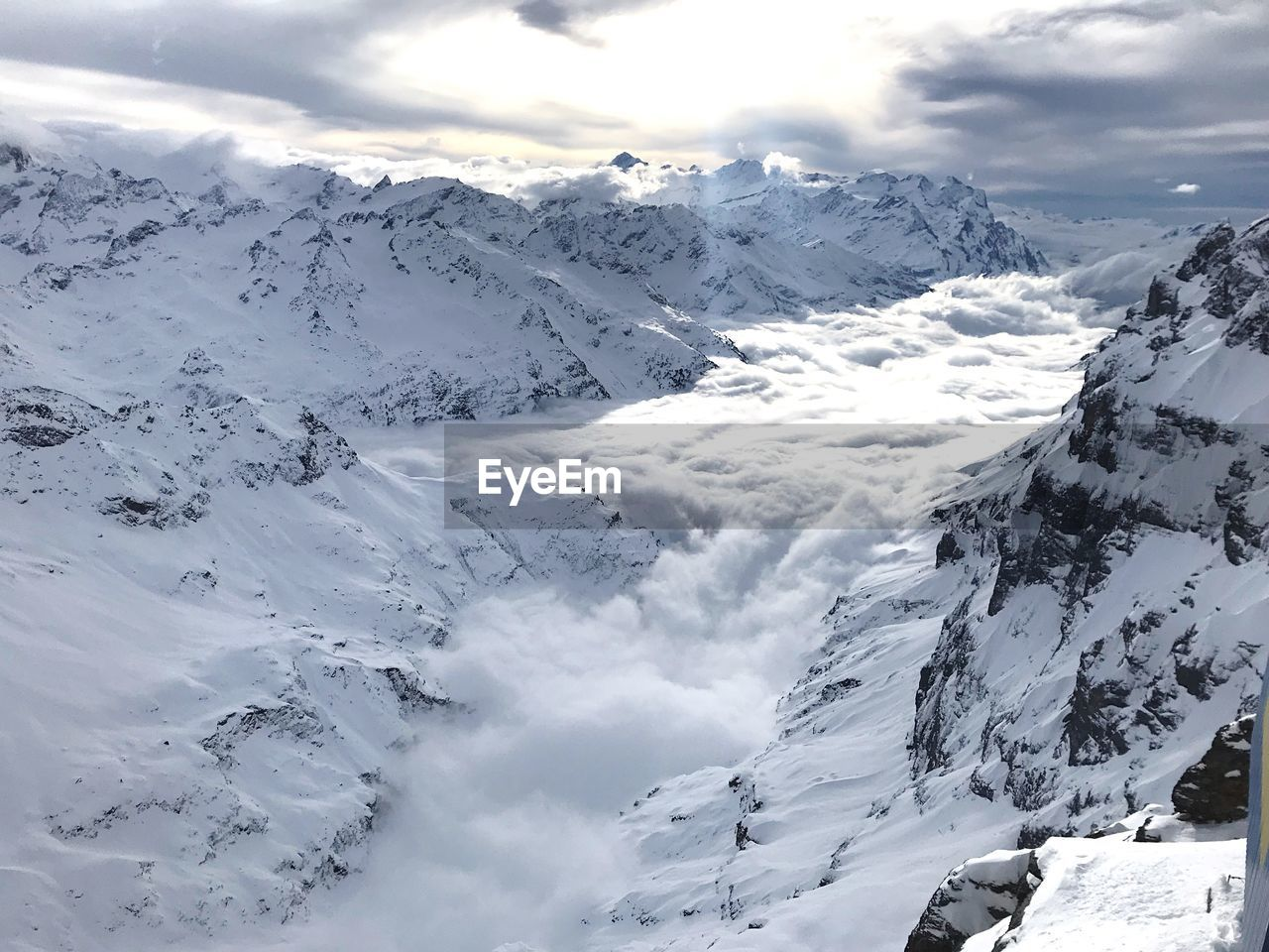 winter, cold temperature, snow, beauty in nature, scenics - nature, mountain, snowcapped mountain, cloud - sky, tranquil scene, sky, tranquility, white color, mountain range, environment, landscape, day, non-urban scene, nature, no people, mountain peak, formation