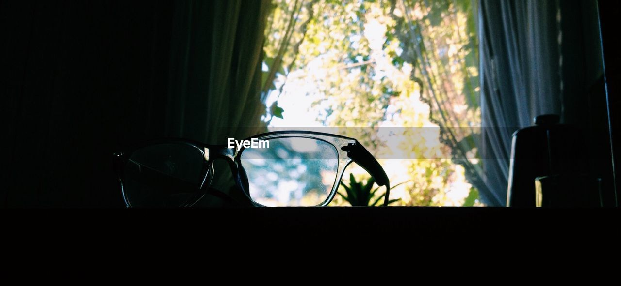 Glasses on window at home