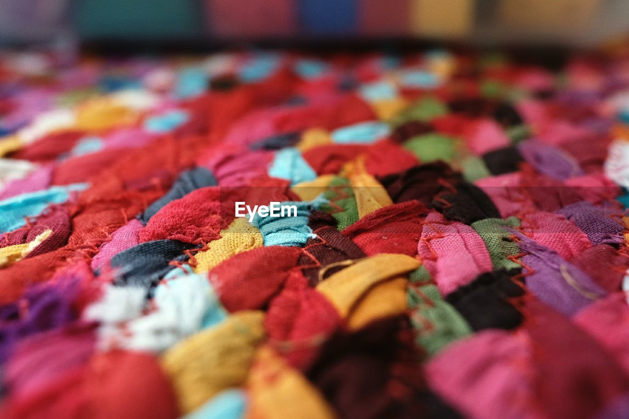 multi colored, variation, selective focus, indoors, backgrounds, no people, close-up, full frame, abundance, choice, large group of objects, day