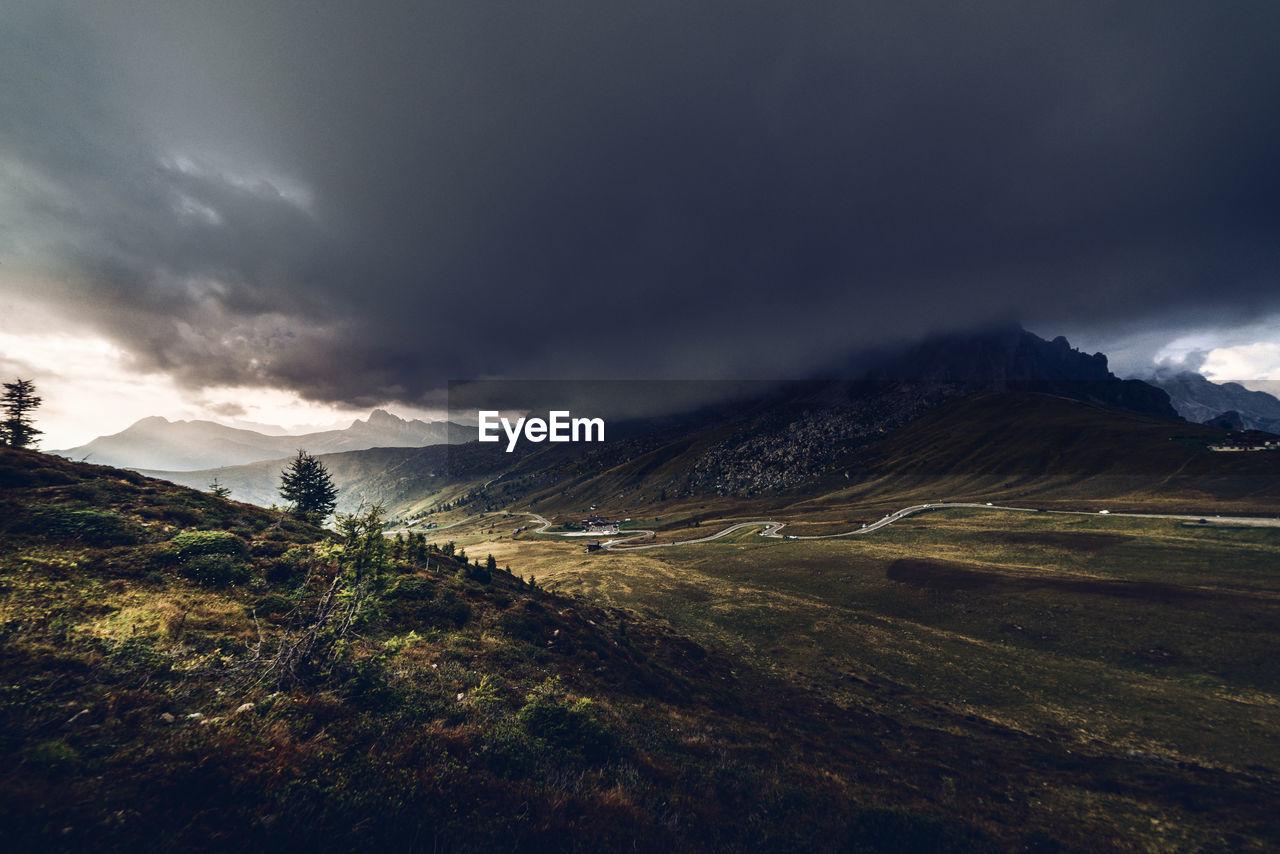 Bad weather at giau pass big cloud on ra gusela peak, dolomites unesco
