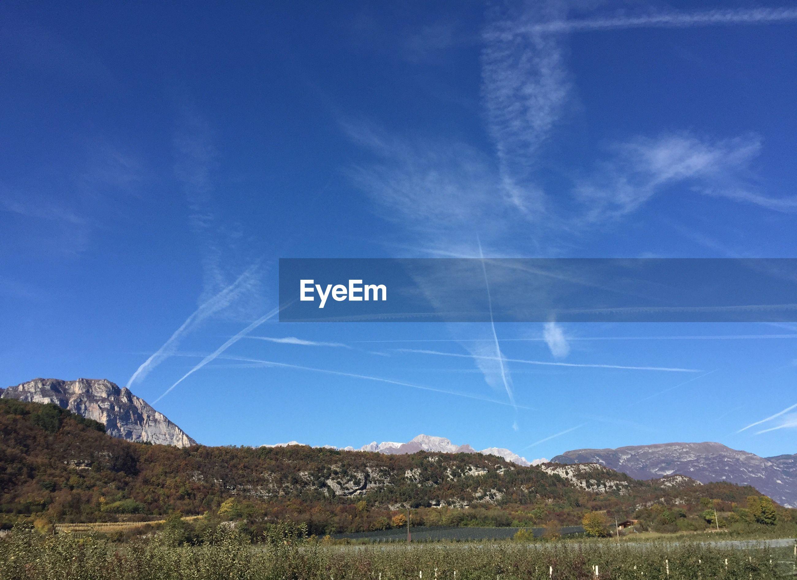 VAPOR TRAILS IN SKY